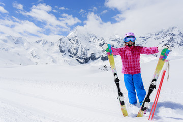 Skiing - lovely skier girl enjoying ski vacation