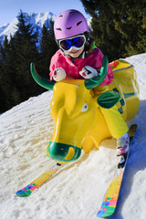 Ski, winter fun - girl enjoying ski vacation