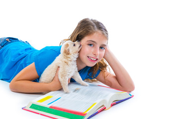 kid girl with puppy chihuahua pet dog at homework