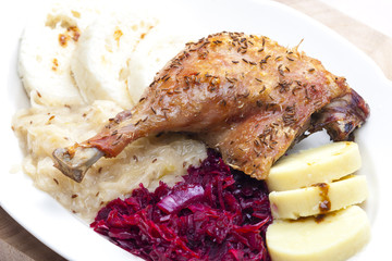 baked duck meat with dumlings and cabbage
