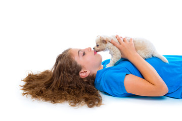 relaxed kid girl kissing puppy chihuahua dog lying