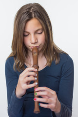 Teenage girl playing the flute