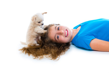 relaxed kid girl and puppy chihuahua dog lying