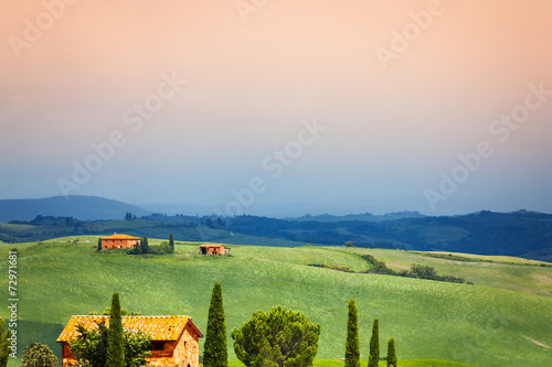 Three houses in Tuscany landscape, Italy - 72971681