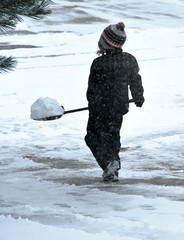 Girl shoveling snow.