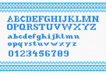 blaues gestricktes Alphabet auf weiß
