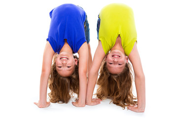 twin kid sisters playing as flexible contortionist