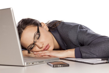 very tired business woman asleep on a laptop