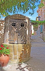 Closed old well in old Town of Tossa de Mar village, Costa Brava