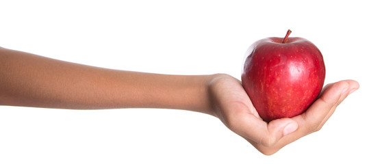 Girl hands holding a red apple over white background