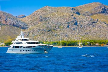 Ship against mountains of Port de Pollenca, Mallorca