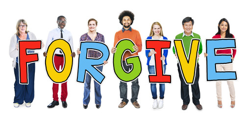Group of People Standing Holding Word Forgive