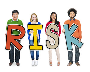 Group of People Standing Holding Word Risk