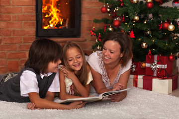 Family reading a story at Christmas time