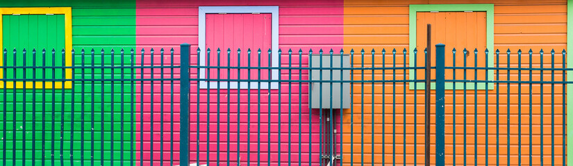 Blue Fence by Colorful Walls