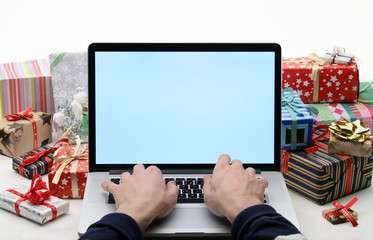 Man buys christmas gifts - online shopping concept