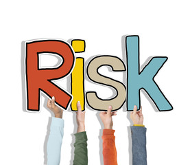 Group of Hands Holding Word Risk