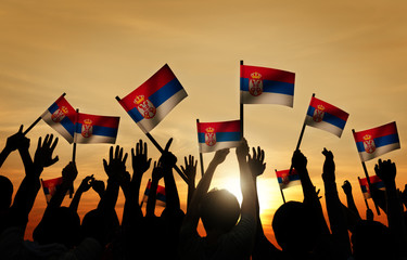 Group of People Waving Flag of Serbia