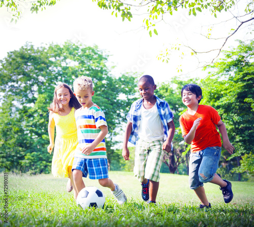 canvas print picture Group of Children Playing Football Concepts