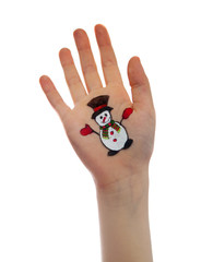 Snowman painted on child's hand. Christmas concept