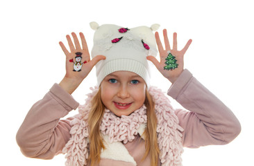 Happy girl demonstrating Christmas symbols painted on her hands.