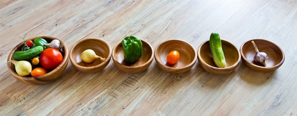 Fresh vegetables in wooden bowls row. Panoramic image