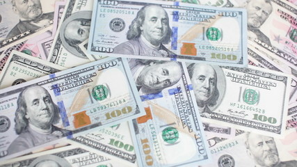 Banknotes of dollas are falling on the table