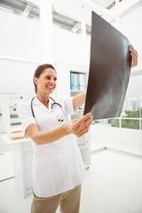 Female doctor examining x-ray in medical office