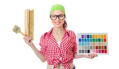 Woman holding paintbrush and color samples