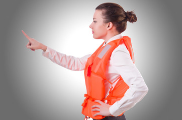 Woman in vest pressing virtual buttons