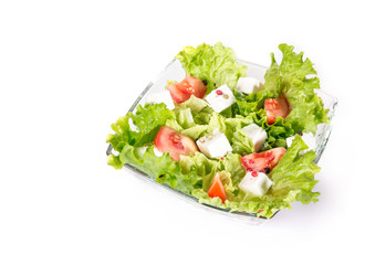Above view of a salad with tomato and cheese
