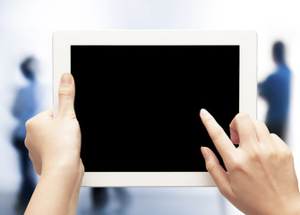female teen hands using tablet pc on blurred people background