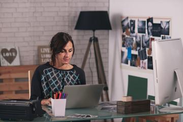 Brunette woman working in her loft