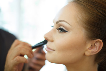 Bride receiving make-up