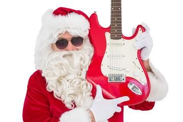 Cool santa showing electric guitar