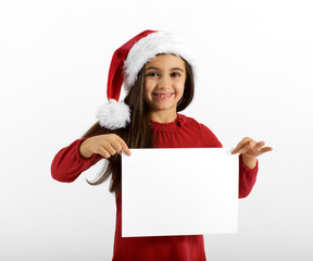 Smiling little girl in a Santa Hat with a sign