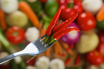 Red hot chilli peppers on fork
