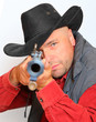 Cowboy with big bore rifle aimed at you. Gun control concept.