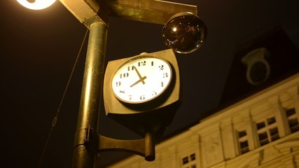 clock on the night street (night city) - building in background