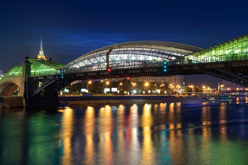 The pedestrian bridge Bogdan Khmelnitsky on night. Moscow citys