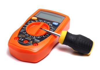 orange multimeter and direct screwdriver