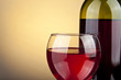 canvas print picture - glass of wine and bottle