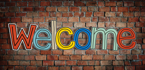 Welcome Word and Brick Wall in Background