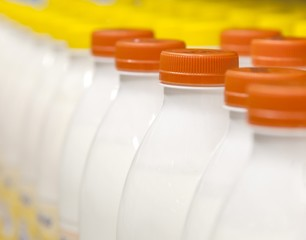 Rows with bottles of milk on the supermarket shelves