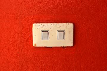 light switch on a orange wall