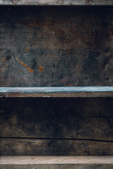 Empty old shelf on wooden background