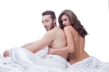 Two sexual partner posing naked in bed