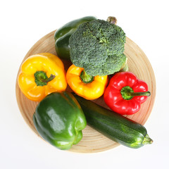 Green,red and yellow bell pepper with broccoli and zucchini