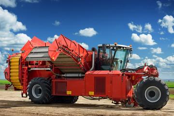 Potato harvester machine on the field