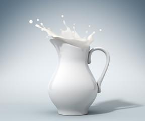 milk splashing from a pitcher